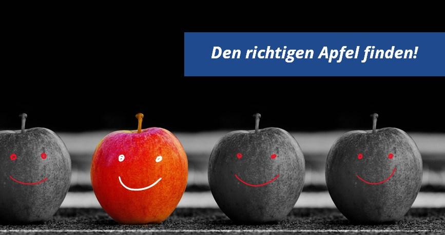 Vier Äpfel von denen einer rot markiert ist